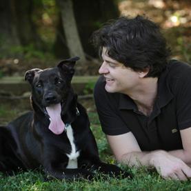 Scientist Brian Hare with his dog Tassie, aka Tasmanian Devil Image: Gretchen Mathison