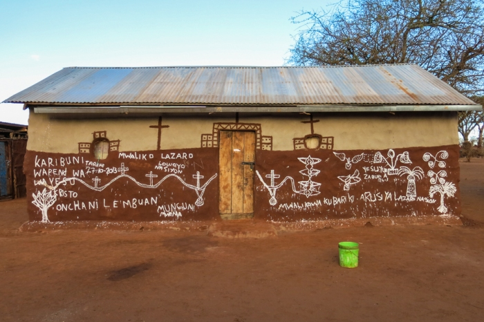 The house of one Maasai family in the village of Loibor Siret. The writing on the right side of the wall celebrates a recent marriage in the family.