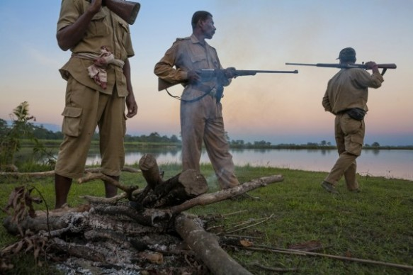 Here, guards in India's Kaziranga National Park patrol for poachers. It's the only reserve in India where guards are allowed to carry guns. (Photograph by Steve Winter/National Geographic)